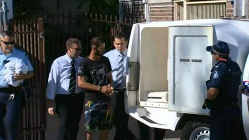 Police take Robert Strebeck into custody. Picture: 9NEWS