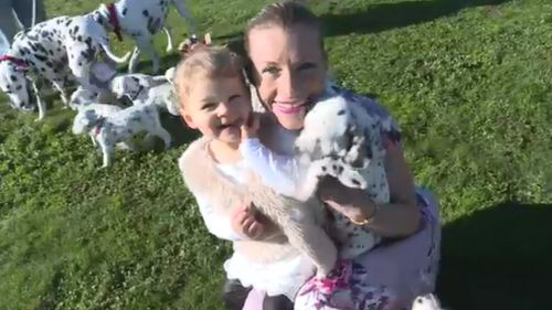 "One of the 18 pups has been named ""Tilly"" by Ms Martin's daughter, Lulu. (9NEWS)"