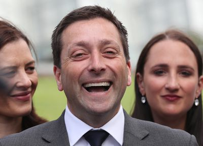 Mr Guy shows off his pearly whites during a press conference at the Ballarat Botanic Gardens.