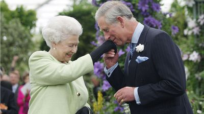 Prince Charles kisses the Queen's hand