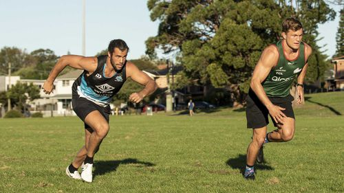 South Sydney Rabbitohs player Liam Knight and Cronulla Sharks player Toby Rudolph keep each other motivated ahead of the NRL season which has been delayed due to Coronavirus. Photographed at Heffron Park, Maroubra.