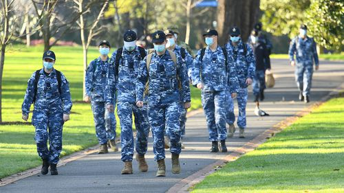 Members of the Australian Defence Force walk through Fitzroy Gardens on August 10, 2020 in Melbourne, Australia.