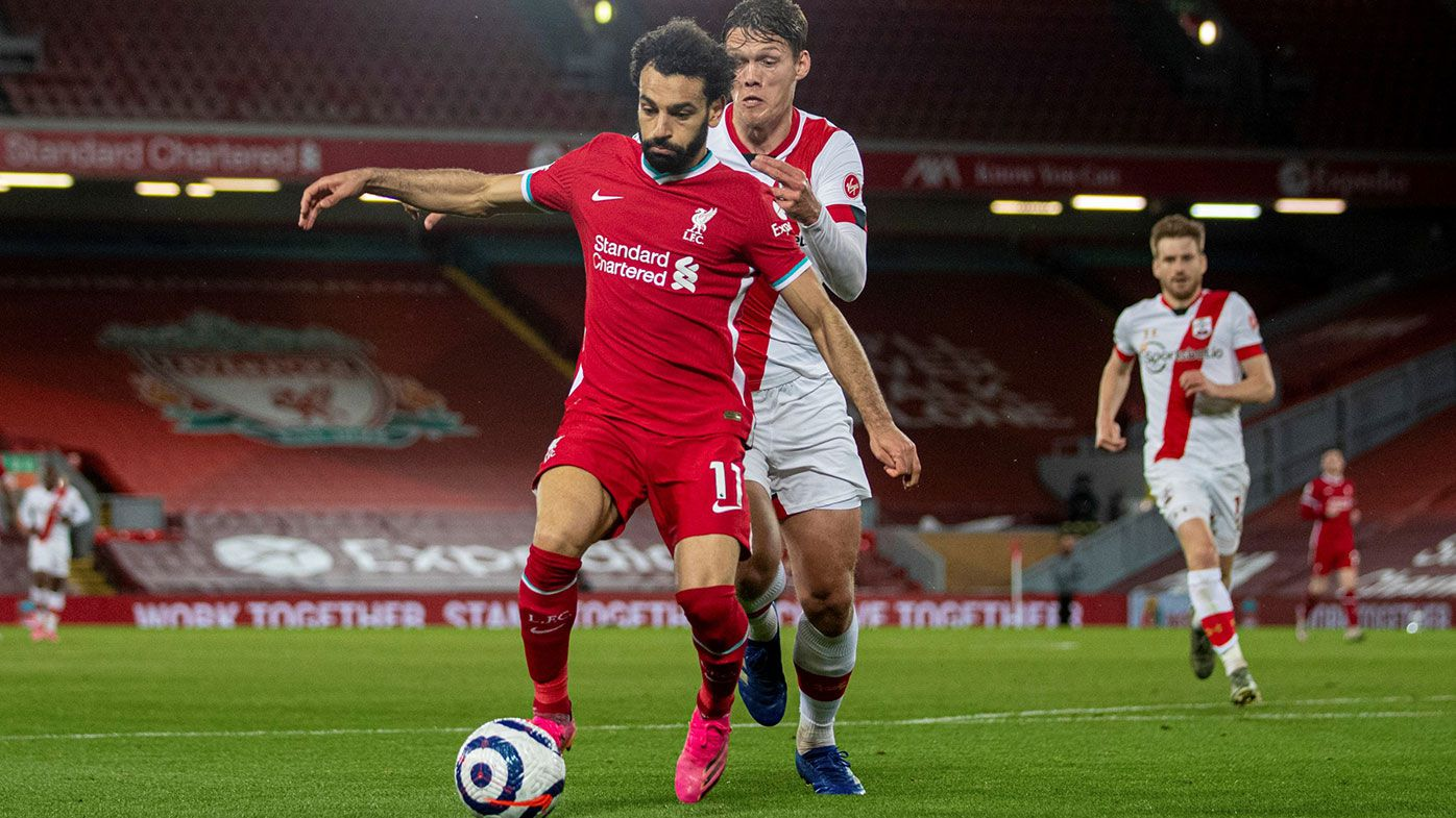 Liverpool's Mohamed Salah L is chased by Southampton's Jannik Vestergaard during the Premier League match between Liverpool and Southampton at Anfield in Liverpool, Britain, May 8, 2021.(Xinhua via Getty Images)