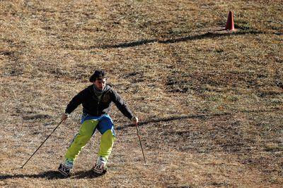 30 December, 2015 -A man practices grass skiing in San Sicario, Italy. (AFP/Marco Bertorello)