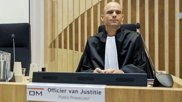Public prosecutor Ward Ferdinandusse, right, waits for the trial to resume at the high security court building at Schiphol Airport, near Amsterdam, Monday, June 8, 2020, for three Russians and a Ukrainian charged with crimes including murder for their alleged roles in the shooting down of Malaysia Airlines Flight MH17 over eastern Ukraine nearly six years ago