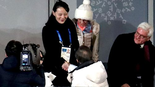 South Korean President Moon Jae (bottom) shakes hands with North Korea's Kim Yo-jong, sister of North Korean leader Kim Jong-un, during the Opening Ceremony of the PyeongChang 2018 Winter Olympic Games. (AAP)