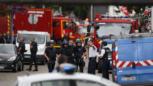 Police and fire trucks arrive at the scene. (AFP)