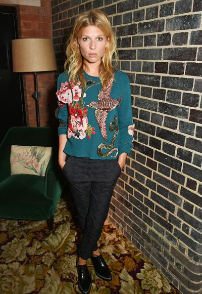 French actress Clemence Poesy balances the heavy embellishment of her Gucci sweater with man style trousers and flat brogues.