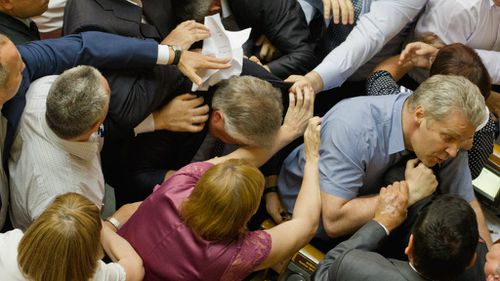 Ukrainian parliamentary deputies from the right-wing party in a tussle with Communist Party leader Petro Symonenko from the hall during a session in parliament in Kiev.