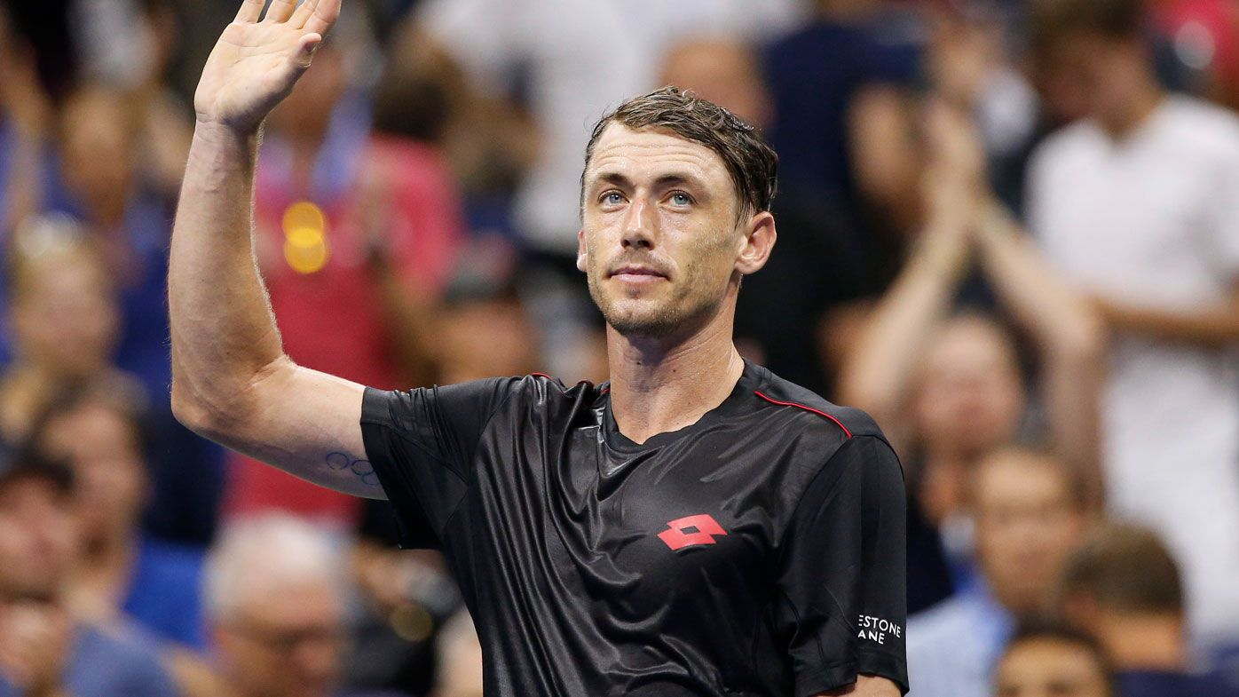 Aussie tennis player John Millman acknowledges the crowd.