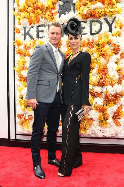 Lleyton and Bec Hewitt. Bec wears a suit from Sass & Bide and millinery from Matcho Suba The Label