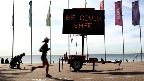 A Covid-19 public message sign at Manly Beach in Sydney, Australia, on Monday, Aug. 30, 2021.