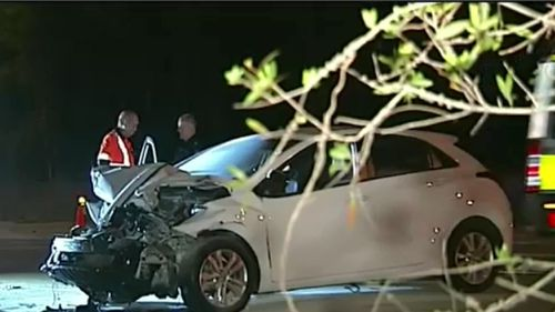 The driver of the white hatchback, a 26-year-old woman, remains in a critical condition. (9NEWS)