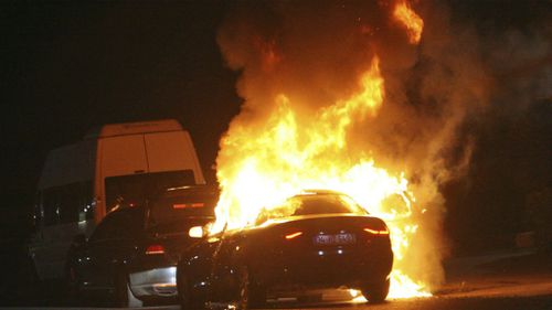 A car burns during firefight between Turkish army and Turkish police, in Istanbul's Taksim square. (AAP)