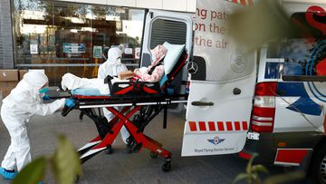 A resident of Epping Gardens Aged Care Facility, where there is a coronavirus outbreak, is taken away in an ambulance today.