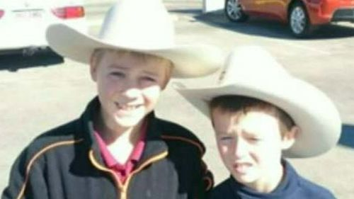 The brothers were killed in a fiery crash on the Warrego Highway last night.