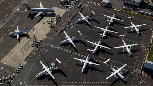Qantas planes are parked on the tarmac at Sydney Airport.