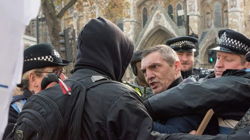 A protester clashes with police outside the Supreme Court. (AFP)