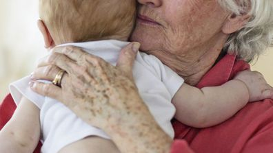 Grandmother holding baby