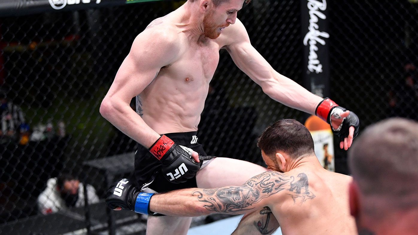 Cory Sandhagen lands a flying knee to knock out Frankie Edgar in their bantamweight fight during the UFC Fight Night event at UFC APEX on February 06, 2021 in Las Vegas, Nevada