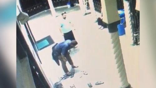 The man is seen keeled over after being punched. (Islamic Society of South Australia / Facebook)