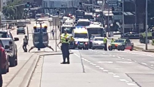 Before authorities arrived to the crash scene, a CareFlight helicopter landed on the busy Pittwater Road, which runs adjacent to Moorilla Road, to help the woman but was later called away (Veronica Fitzpatrick).