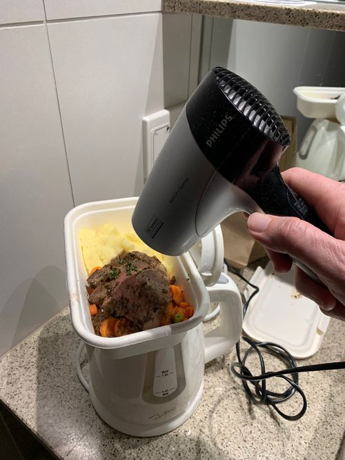 Cameron Croucher has found novel ways to heat up the meals which are delivered to his hotel quarantine room.
