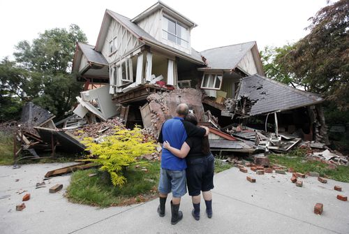 Murray, left, and Kelly James look at their destroyed house in central Christchurch, New Zealand, a day after a deadly earthquake (AP Photo/Mark Baker, File)