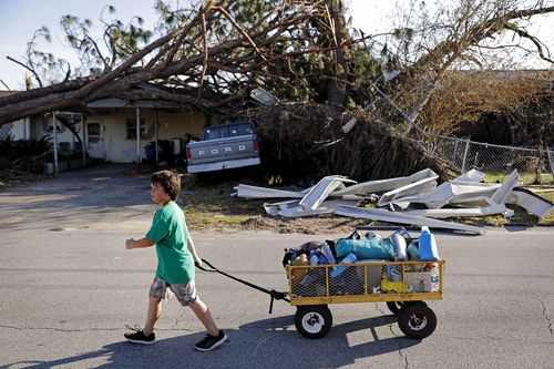 Hurricane Michael brought 250km/h winds and destroyed many properties, killing 17 and stretching food and water supplies.