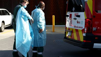 Medical transport workers prepare to enter the Epping Aged Care Home on July 29, 2020 in Melbourne, Australia.