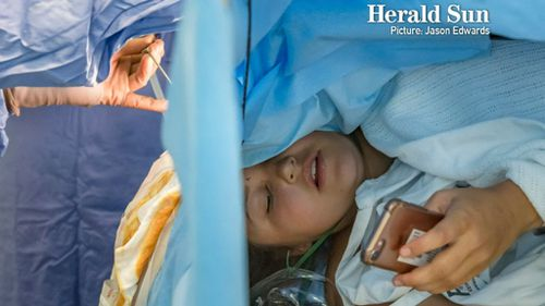 Despite the intensive nature of the surgery, the brave teen remained calm and sent a few texts. (Herald Sun/ Jason Edwards)
