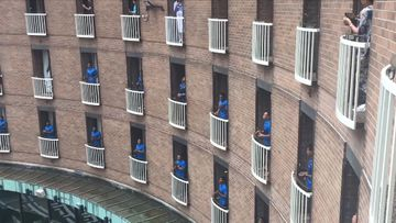 Fijian rugby players' rousing song on their balconies.