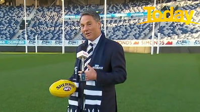 Decked in his team colours, Marles was there to support the Geelong Cats.