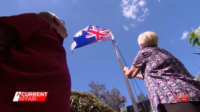 Woman says she'll 'go to jail' before removing her Australian flag