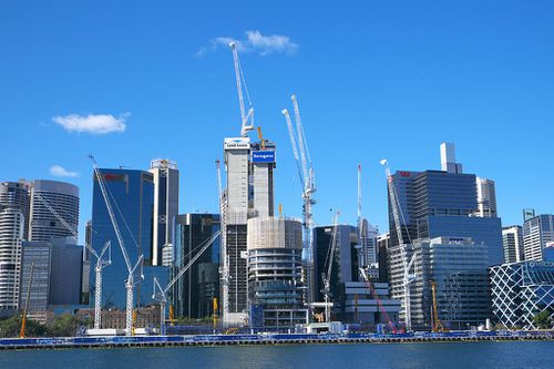 The 24-year-old who illegally climbed to the top of a Darling Harbour crane and jumped off has been charged.