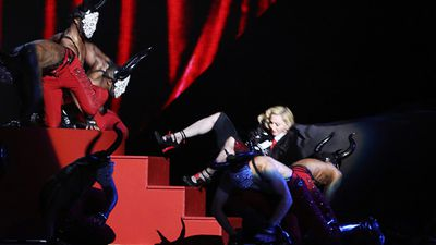 Madonna fell off the stage during her performance but got back up right away and continued performing. (Getty)