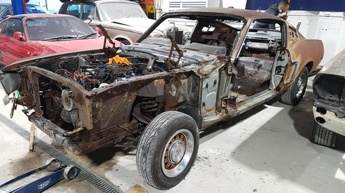When a Ford specialist in the UK bought a 1968 Mustang GT last year, he didn't expect to get the previous owner's remains along with his new purchase.