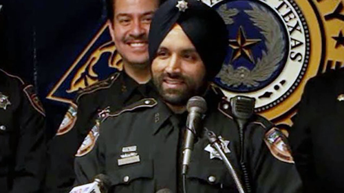 """Harris County Deputy Sandeep Dhaliwal was shot """"from behind... at least a couple of times"""" while conducting a traffic stop, officials said."""