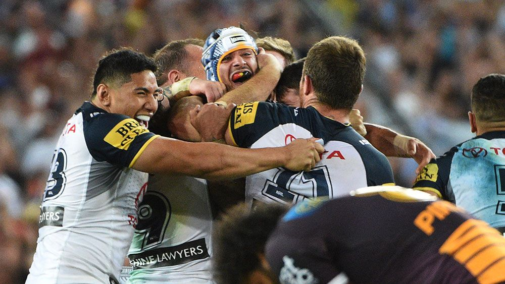 Johnathan Thurston and Cowboys teammates celebrate their grand final win. (AAP)