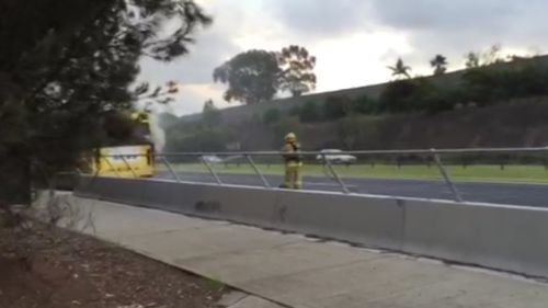 Emergency services rushed to the scene of the fire after smoke was seen pouring from the bus. (9NEWS)