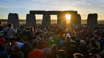 people celebrating the dawn of the longest day in the UK (Ben Birchall/PA Wire).