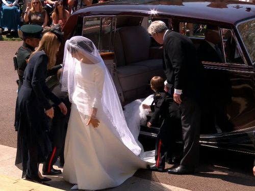 Meghan made a jaw-dropping appearance at Windsor Castle for her wedding. (9NEWS)