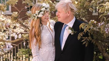 British Prime Minister Boris Johnson poses with his wife Carrie Johnson in the garden of 10 Downing Street following their wedding at Westminster Cathedral, May 29, 2021