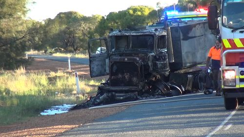 The driver of the truck just managed to escape his vehicle before it burst into flames. (9NEWS)