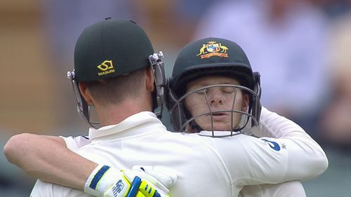 Smith embraces his skipper upon reaching a brilliant hundred. (9NEWS)