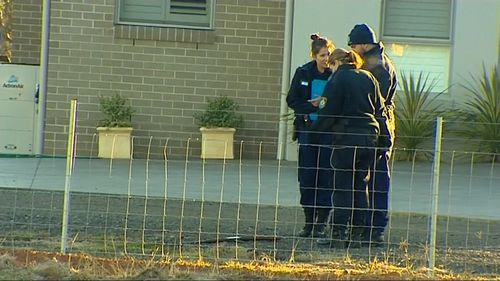 Police investigating the crime scene at Bringelly. Picture: 9NEWS
