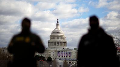 Law enforcement stand near the Capitol ahead of the inauguration of President-elect Joe Biden and Vice President-elect Kamala Harris, Sunday, Jan. 17, 2021, in Washington. (AP Photo/David Goldman)
