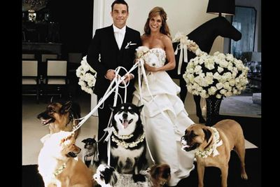 As if Robbie was ever going to have a straight-up wedding! The Take That singer insisted on having his dogs as bridesmaids.