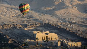 A hot air balloon flies over the temple of Ramsis III at Medinet Habu on the west bank of the Nile River in Luxor, Egypt, in 2016. (Associated Press)
