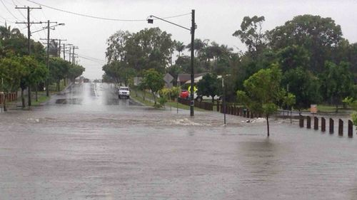 Heavy rainfall caused local flooding on Henderson Road at Burpengary. (Supplied: QFES)